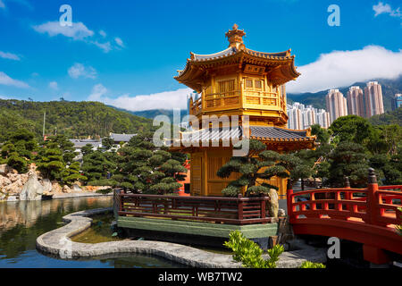 Pavilion of Absolute Perfection and Wu Bridge in Nan Lian Garden, Chinese Classical Garden. Diamond Hill, Kowloon, Hong Kong, China. - Stock Photo