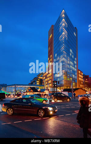Potsdamer Platz with car transport and Modern building architecture at Bahnhof Train Station in German City centre in Berlin in Germany in Europe. Bui - Stock Photo