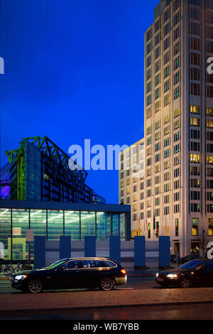 Potsdamer Platz and car transport and Modern building architecture at Bahnhof Train Station in German City centre in Berlin in Germany in Europe. Buil - Stock Photo