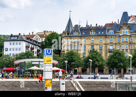 Stuttgart, Germany, August 16, 2019, Stairs of marienplatz square in inner city of stuttgart with many people enjoying the sun in summer at station of - Stock Photo