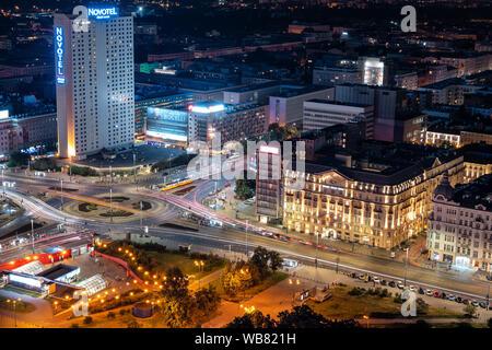 Warsaw, Poland - June 14, 2019: Dmowski Roundabout (Rondo Dmowskiego) and Jerusalem Avenue (Aleje Jerozolimskie) aerial view in the city center at nig - Stock Photo