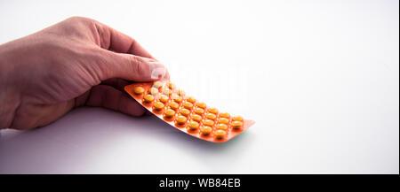 Alloa, Scotland - 13 August 2019: Yellow Rutinoscorbin pills - Stock Photo