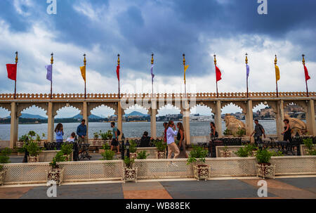 ourist visiting 17th century palace today Jagmandir luxurious hotel located on the lake Pichola island, Udaipur, Rajasthan, India. - Stock Photo