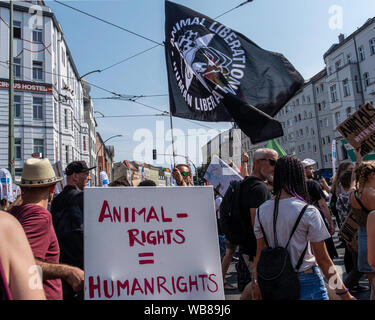 Rosenthaler Platz, Mitte, Berlin,Germany. 25th August 2019. Animal Rights Protest at Rodenthaler Platz brings traffic to a halt. Banner-carrying protesters marched through central Berlin and lay down at Rosenthaler Platz  in a silent demo. Credit: Eden Breitz/Alamy - Stock Photo