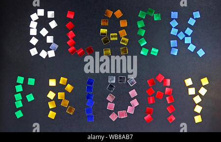 The words BLACK FRIDAY is laid out of colour confetti on black background as a school blackboard. Black friday sale concept - Stock Photo
