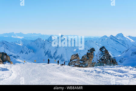 Hintertux Glacier ski resort in Zillertal in Tyrol in Austria in winter in Alps. Alpine mountains with snow. Downhill fun. Family vacation. Blue sky a - Stock Photo