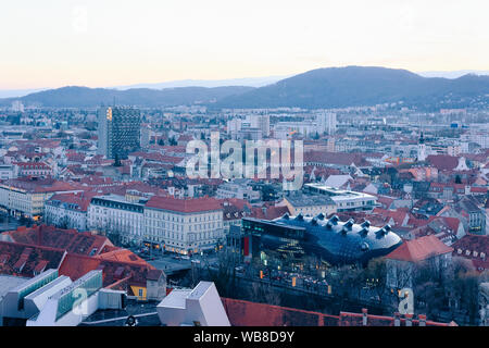 Panoramic view and cityscape with Kunsthaus art museum at Old city of Graz in Austria. Styria in Europe. Rooftop view from Schlossberg castle hill - Stock Photo