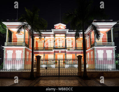 chinese government headquarters colonial heritage building landmark in macau city at night - Stock Photo