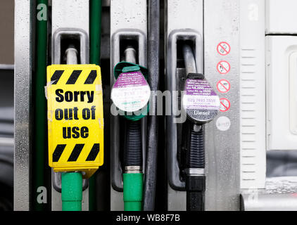 Fuel diesel shortage at petrol station pump with sorry out of order sign - Stock Photo