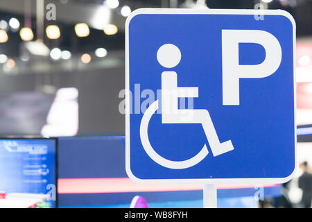 disabled parking or Wheelchair parking sign In the parking lot of the mall, Do the parking for the disabled, Slope area for wheelchairs. - Stock Photo