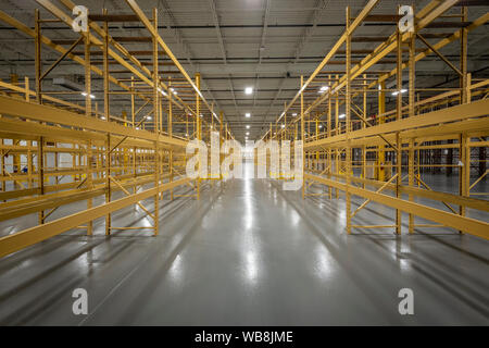 Empty Shelves In Empty Warehouse - Stock Photo