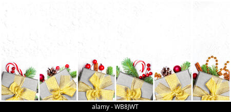 Christmas composition set of silver gifts with gold ribbon, bow, green Xmas fir branch, red holly berries and baubles on white background - Stock Photo