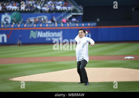 New York, USA. 24th Aug, 2019. Huang Ping, Chinese Consul General in New York, throws a ceremonial first pitch to start an MLB game between the Mets and the Atlanta Braves in Citi Field, New York, the United States, Aug. 24, 2019. The 12th annual event 'An Evening of Chinese Culture' was held on Saturday evening in New York's Citi Field, an iconic stadium serving as the home field for the New York Mets. Credit: Qin Lang/Xinhua/Alamy Live News