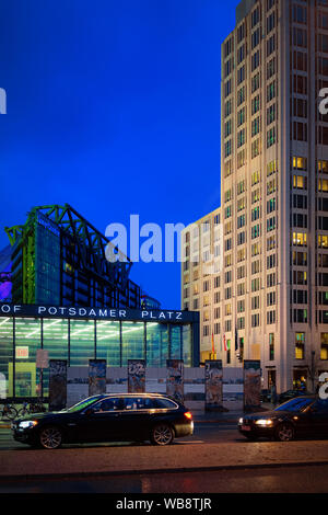 Berlin, Germany - December 12, 2017: Potsdamer Platz and car transport and Modern building architecture at Bahnhof Train Station in German City centre in Berlin in Germany. Building architecture - Stock Photo