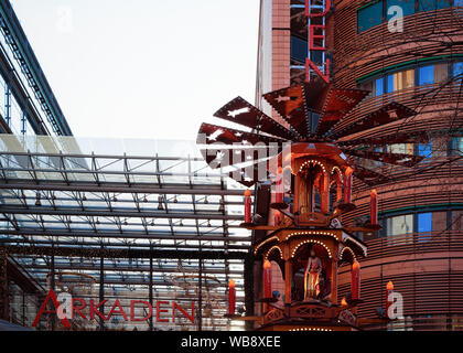 Berlin, Germany - December 13, 2017: Wooden Christmas Pyramid with Nativity Scene at Christmas market in Potsdamer platz in Berlin in Germany in Europe in winter. - Stock Photo
