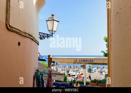 Positano, Italy - September 30, 2017: Terraced street cafe in Positano town on Amalfi Coast and Tyrrhenian Sea in Italy in summer. Tables at Restaurant with Beautiful Mediterranean view near Sorrento - Stock Photo