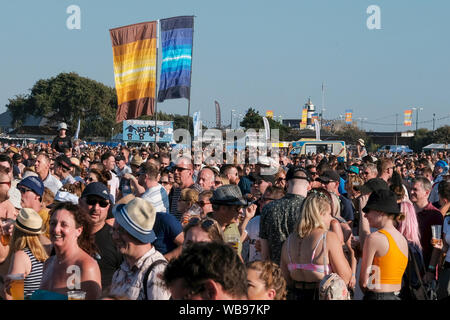 Portsmouth, Hampshire, UK. August 25th 2019. Flags and crowd at main stage watching Johnny Borrell lead singer and guitarist with Razorlight performing live on stage at Victorious Festival, Southsea, Portsmouth, Hampshire, UK Credit: Dawn Fletcher-Park/Alamy Live News - Stock Photo