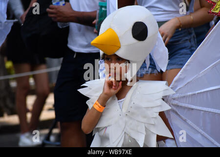 London, UK. 25th Aug, 2019. Thousands attend the first day of the Notting Hill Carnival in west London on August 25, 2019. Nearly one million people are expected by the organizers regradless of the wet weather Sunday and Monday in the streets of west London's Notting Hill to celebrate Caribbean culture at a carnival considered the largest street demonstration in Europe, London, UK. Credit: Picture Capital/Alamy Live News - Stock Photo