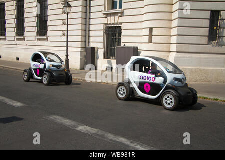 Paris, France - July 7, 2018: Two Renault electric cars with Indigo inscription in front of the Palais de Justice in Paris - Stock Photo