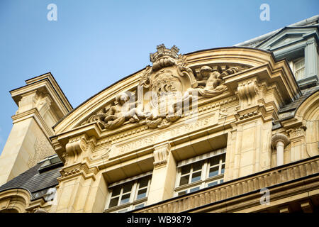 Paris, France - July 7, 2018: Bottom view of the architectural composition at the main entrance to the Sorbonne University in Paris with a bas-relief - Stock Photo