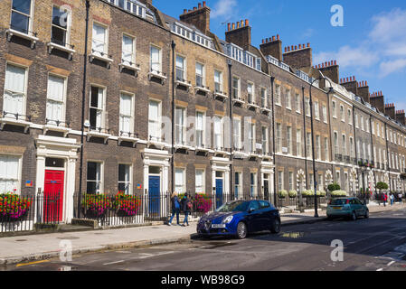London, UK - August  2019: Local street with luxury property tenement houses in Georgian British style in the exclusive area of Bloomsbury, Central Lo - Stock Photo