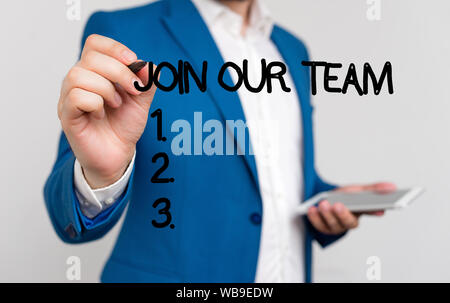 Conceptual hand writing showing Join Our Team. Concept meaning inviting someone to join in your local group or company Businessman blue suite and whit - Stock Photo