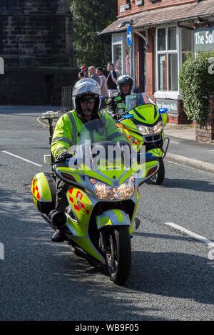 Blood bikes with emergency flashing blue lights, Ormskirk, Lancashire, UK - Stock Photo