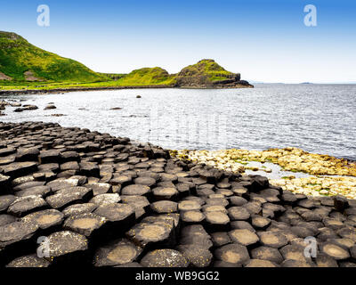 Giant's Causeway, Northern Ireland, UK. Unique hexagonal and pentagonal geological formations of volcanic basalt rocks at the Atlantic coast, partly c