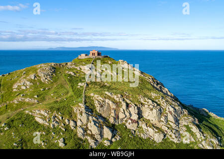 Torr Head headland, rocky cliff and peninsula with ruins of old fort in County Antrim, Northern Ireland, near Ballycastle. Aerial photo with far view - Stock Photo