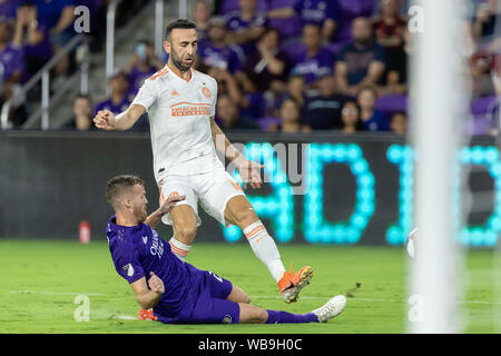 August 23, 2019, Orlando, Florida, U.S.A: Orlando City midfielder ORIOL ROSELL (20) steals the ball away from Atlanta United midfielder JUSTIN MERAM (14) during the MLS game at Exploria Stadium in Orlando, Florida. (Credit Image: © Cory Knowlton/ZUMA Wire) - Stock Photo
