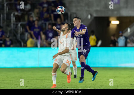 August 23, 2019, Orlando, Florida, U.S.A: Atlanta United midfielder JUSTIN MERAM (14) gets a header against Orlando City defensemen KYLE SMITH (24) during the MLS game at Exploria Stadium in Orlando, Florida. (Credit Image: © Cory Knowlton/ZUMA Wire) - Stock Photo