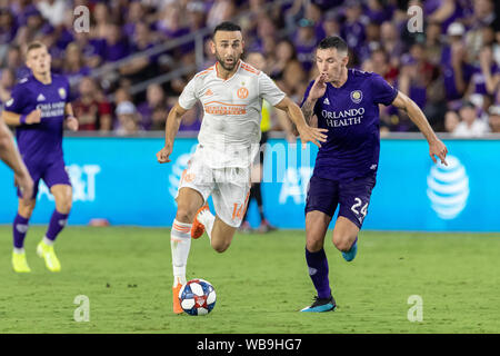 August 23, 2019, Orlando, Florida, U.S.A: Atlanta United midfielder JUSTIN MERAM (14) in action against Orlando City defensemen KYLE SMITH (24) during the MLS game at Exploria Stadium in Orlando, Florida. (Credit Image: © Cory Knowlton/ZUMA Wire) - Stock Photo