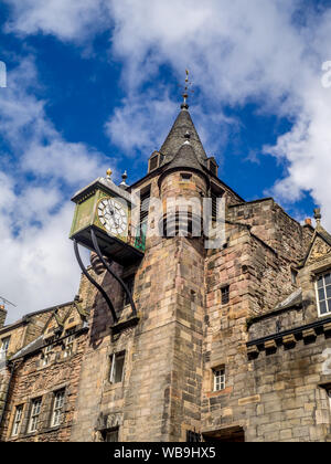 Looking up at the tower and spire of Canongate Tolbooth situated along the Royal Mile in Edinburgh Scotland. - Stock Photo