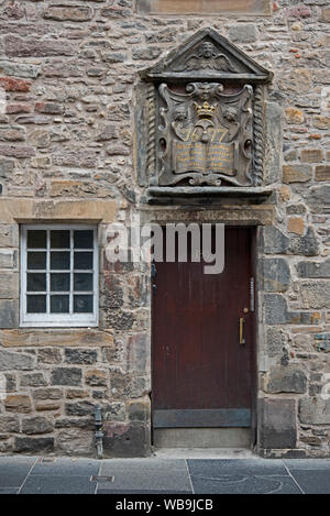 17th Century carving at the doorway to Bible Land, a restored 17th century tenement building, in the Canongate on the Royal Mile, Edinburgh, Scotland. - Stock Photo
