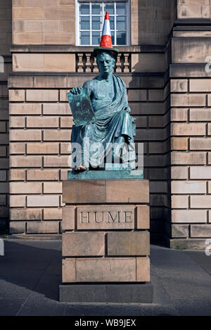 Statue of the philosopher and historian David Hume, complete with traffic cone, by sculptor Sandy Stoddart on Edinburgh's Royal Mile. - Stock Photo