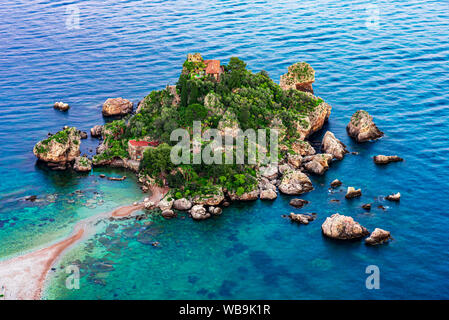 Taormina, Sicily, Italy: Beautiful landscape and seascape with beach and island Isola Bella at sunset - Stock Photo
