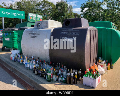 Recycling point in a supermarket car park in the United Kingdom. - Stock Photo
