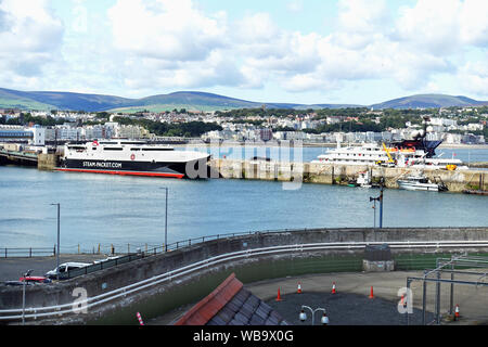 Douglas Harbour, Isle of Man, with the high-speed Liverpool ferry Manannan on her berth. She is named after an Irish mythological sea god. - Stock Photo