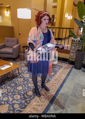 Good Time Girls is a company that takes people on historical walking tours of Bellingham, WA. The guides dress in 1920s flapper era clothing and have a great sense of humor. - Stock Photo