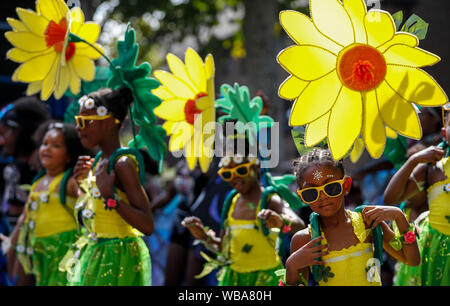 London, UK. 25th Aug, 2019. Performers participate in the 2019 Notting Hill Carnival Family Day in London, Britain on Aug. 25, 2019. Originated in the 1960s, the carnival is a way for Afro-Caribbean communities to celebrate their cultures and traditions. Credit: Han Yan/Xinhua/Alamy Live News - Stock Photo