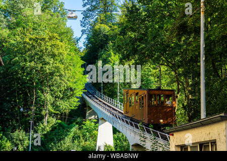 Stuttgart, Germany, August 16, 2019, Brown wooden historical cable car number 2 of funicular railway driving up from suedheimer platz square to heslac - Stock Photo