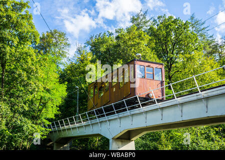 Stuttgart, Germany, August 16, 2019, Historical brown wooden car train, a special funicular railway driving up from suedheimer square to heslach throu - Stock Photo