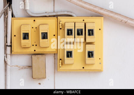 Old Electrical switchboard  on the wall. - Stock Photo