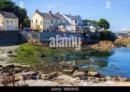 8 August 2019 The rear ofa  small general store with advertising boards overlooking the harbour in Ardglass County Down Northern Ireland during the vi - Stock Photo