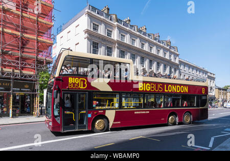 Big Bus Tours open top tour bus taking tourists around Central London  sightseeing from the bus, in the City of Westminster, London, England, UK. - Stock Photo