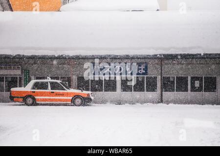 JAN 20, 2014 Aomori, JAPAN : Japan taxi cab at Goshogawara Station,  waiting for passenger during winter time. - Stock Photo