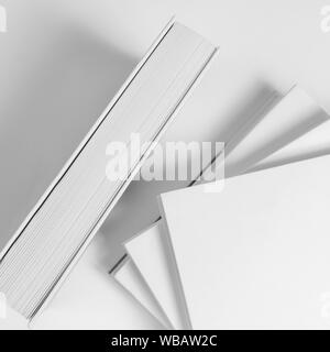 The composition with some white books on the table - Stock Photo