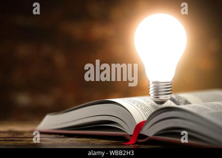 Light bulb on the open book. Idea and creativity concept background. 3d illustration. - Stock Photo