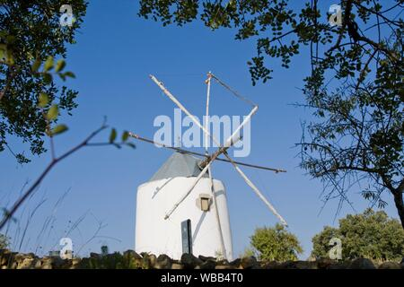 View of a typical portuguese windmill on top of the hill. - Stock Photo