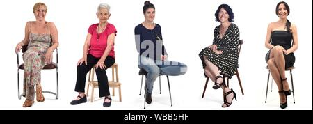 group of women sitting on chair on white background. - Stock Photo